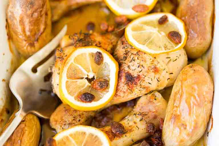 sliced roast chicken with lemon slices